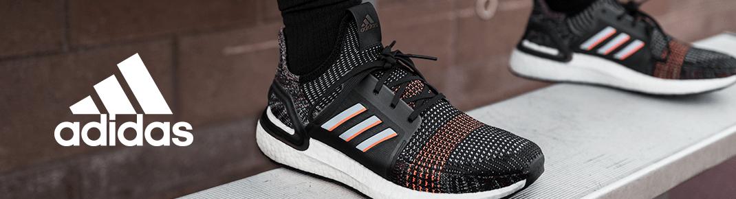 Schuhe und Kleidung Adidas