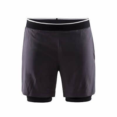 Kalhoty Craft Šortky Charge 2 v 1 tmavě modrá
